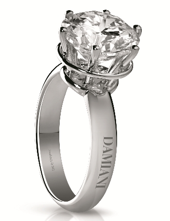 A Damiani Must In White Gold With Four Or Six Gs Hold Together By Circle To Enhance Further The Diamond