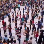 Men on Stilts + Balloons + Huge Flashmob = Awesome Proposal