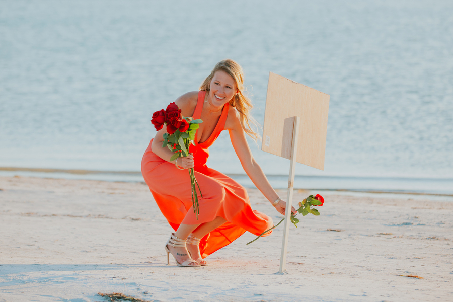 beach proposal sign