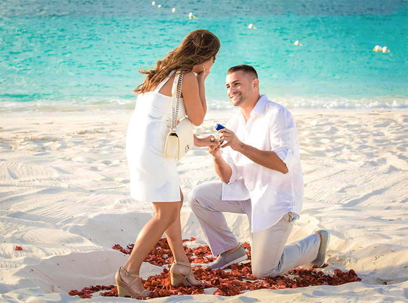 beach proposal love beautiful couple